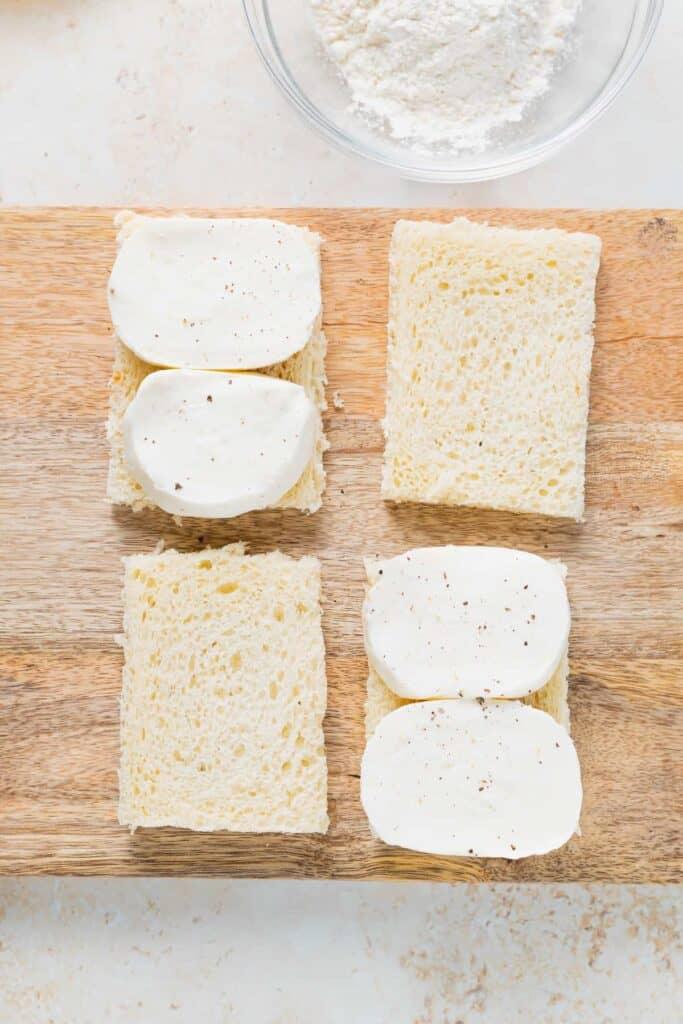 sliced fresh mozzarella on white bread, ready to be made into mozzarella in carrozza