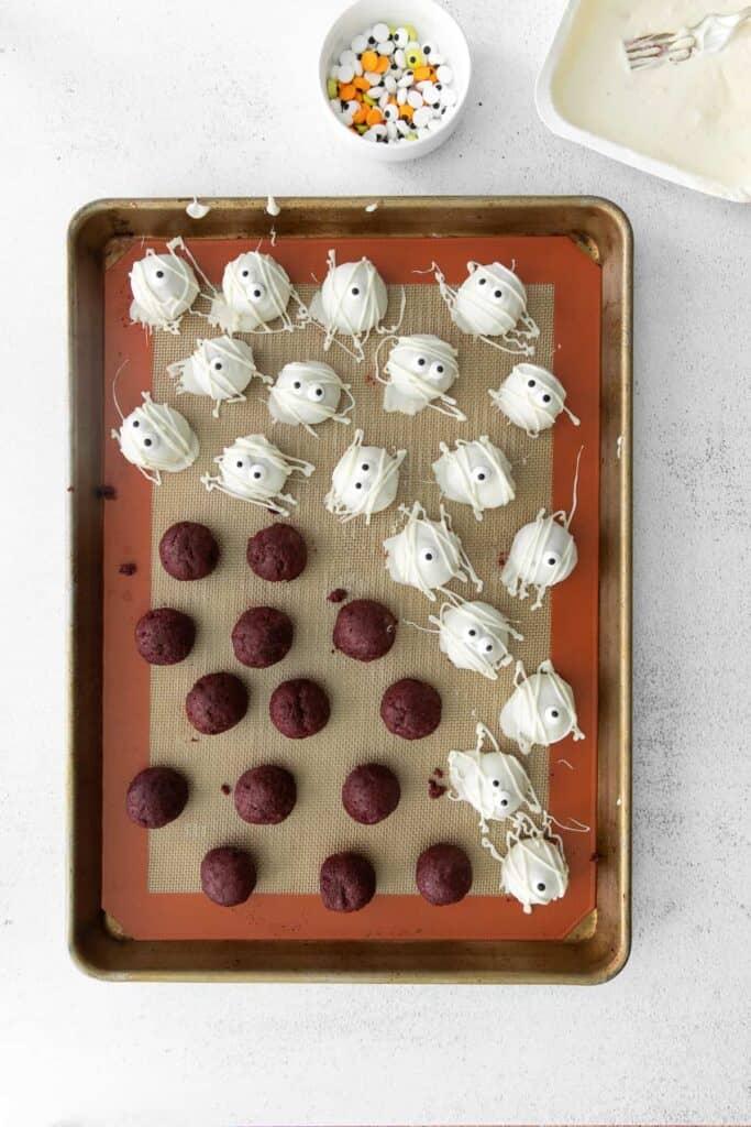 dipped red velvet truffles on baking sheet