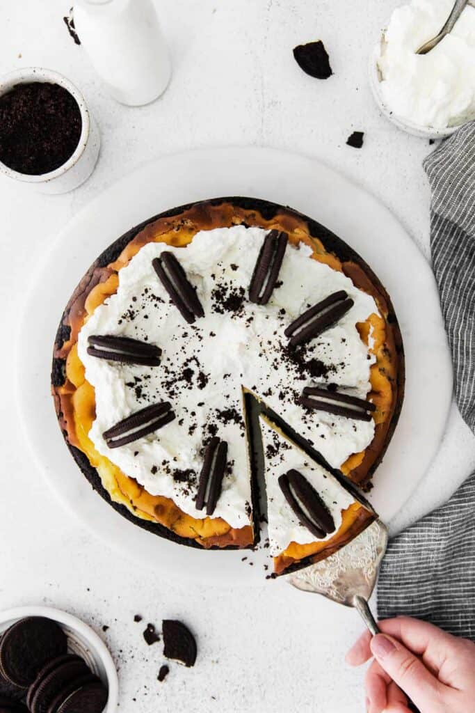 oreo cheesecake topped with whipped cream and oreos