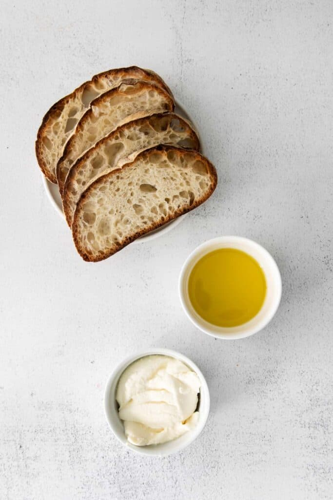 Bread, olive oil, and ricotta cheese.