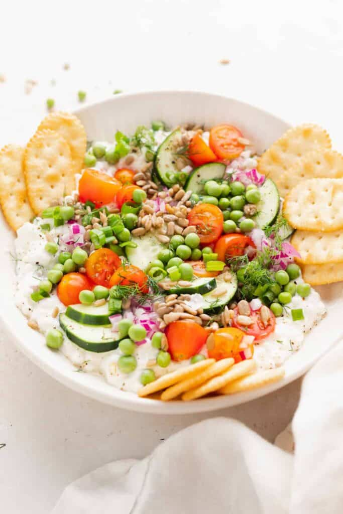 cottage cheese salad with crackers around it for dipping