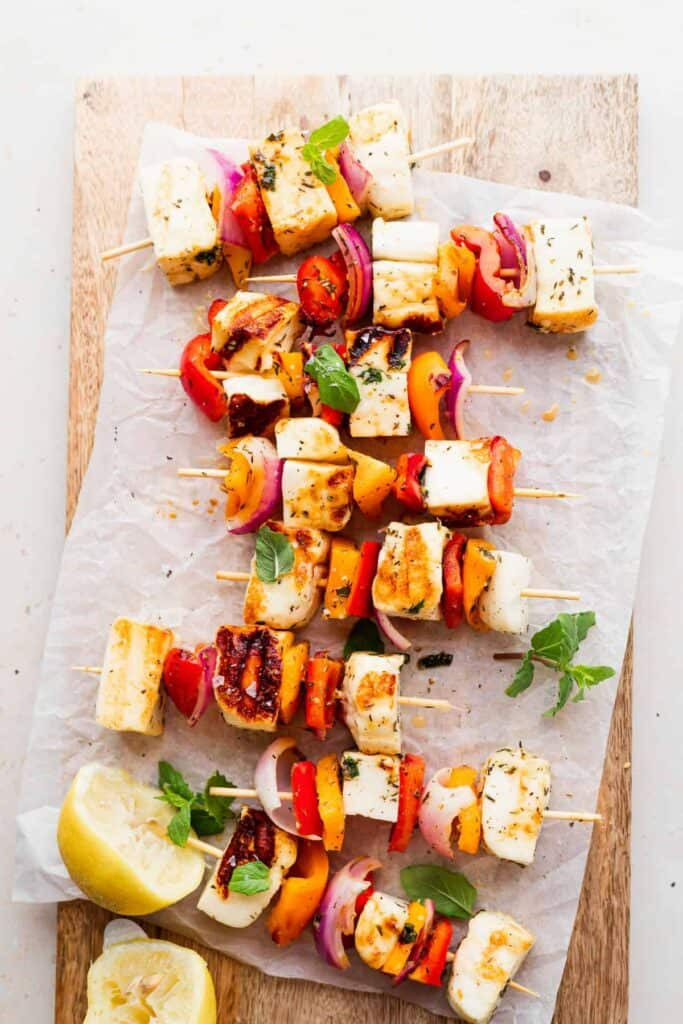 grilled halloumi skewers on a cutting board, ready to be served