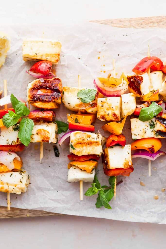 grilled halloumi skewers in a close up photo that highlights the bright vegetables