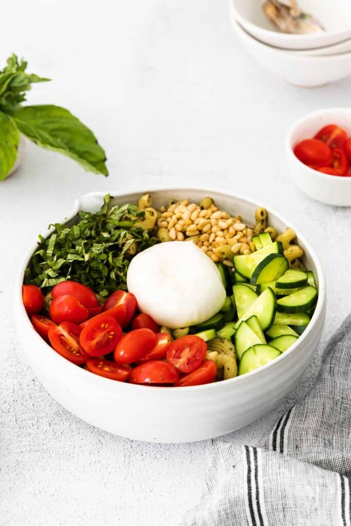 another view of pesto pasta salad with burrata in a bowl