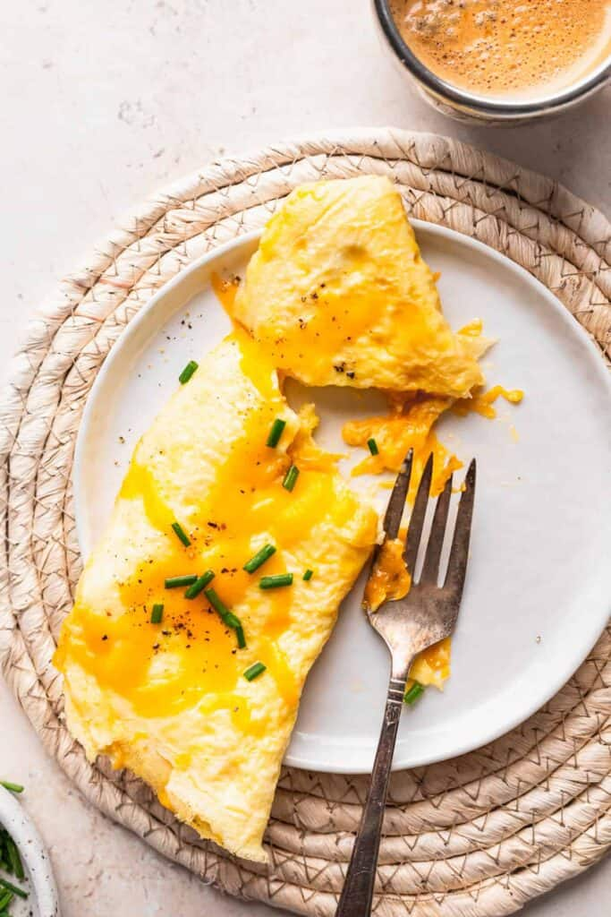 cheese omelette on a plate with a fork