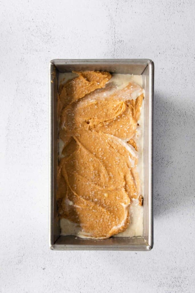 pumpkin cream cheese bread in a loaf pan ready to be baked